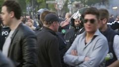 Young men take selfies with riot police, 1st of May celebrations, Berlin Stock Footage