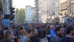 Crowd of many people on 1st of May celebrations, busy street, Berlin Stock Footage