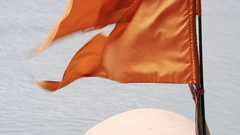 Orange religious Hindu flag moves in the wind, close up, Rishikesh, India Stock Footage