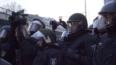 Riot police officers film video record for evidence of violence, Berlin Stock Footage