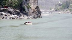 Tourists rafting in holy Ganges river, sunny day, Rishikesh, India Stock Footage