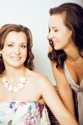 Mature woman sisters twins at home interior, lifestyle people concept Stock Photos