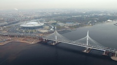 Aerial view of the stadium Zenit arena and modern Cable stayed bridge across the Stock Footage