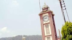 The Parmarth Niketan Ashram clock tower, Ram Jhula, Rishikesh, India Stock Footage