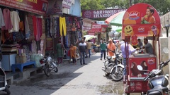 Lakshman Jhula street, baba, ice-cream cart, shops, Rishikesh, India Stock Footage