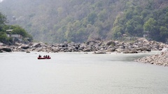 Tourists rafting down holy Ganges river, Rishikesh, India Stock Footage