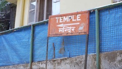 Temple direction sign, arrow pointing, English and Hindi languages Stock Footage
