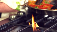 Sliding delicious steamiing  Paella dish over hot flame shot Stock Footage
