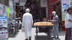 Man selling tomatoes from his cart, Ram Jhula, Rishikesh, India Stock Footage