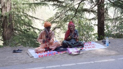 Old Rajasthani Gypsy couple sing, play traditional music, roadside, India Stock Footage