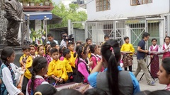 Cute Tibetan children kids choir perform at Dalai Lama Complex, India Stock Footage