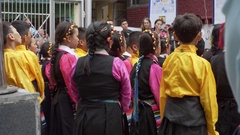 Cute Tibetan children kids choir sing and dance, Dalai Lama Complex, India Stock Footage