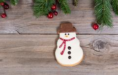 Single frosted snowman cookie for the holiday season Stock Photos