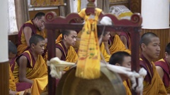 Tibetan youth, young monks chant mantras, pray, temple ceremony, India Stock Footage