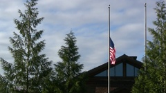 Waving flag at half mast Stock Footage