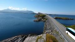 Aerial following tour bus along atlantic ocean road Norway Stock Footage