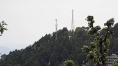 Cellphone mobile communication network antenna towers, forest mountain Stock Footage