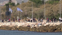 4K People walk relax in public park man fishing in port Athens recreation place Stock Footage