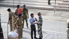 Man talks to soldier official at Wagah border ceremony, India Stock Footage