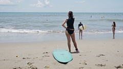 Girl Checking Spot Surfing Indonesia Slowmotion Stock Footage