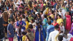 Happy colorful Indian women dance, crowd party at Wagah border ceremony Stock Footage