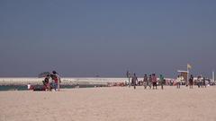 Dubai beach 4K Indians and Arabian people walking on sand seaside vacation 4K Stock Footage