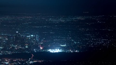 LA Night Cityscape Aerial Shot from Mountain Top - Clouds Time Lapse Stock Footage