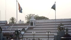 India and Pakistani flag prepare to be lowered, Wagah border gate ceremony Stock Footage