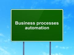 Finance concept: Business Processes Automation on road sign background Piirros