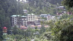 View of Dharamkot tourist village mountain town, Himalaya mountain forest Stock Footage