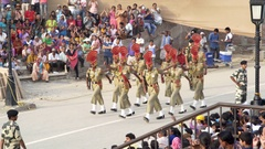 Male border guard soldiers march, Wagah crossing ceremony, colorful show Stock Footage
