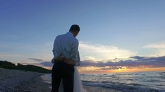 Wedding. Newly married couple on the beach at amazing sunset. Stock Footage