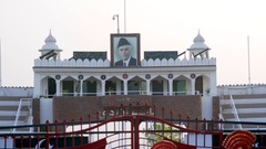Muhammad Ali Jinnah portrait, Pakistani border gate guard, Wagah, India Stock Footage