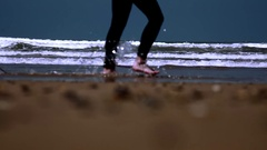Surfer walking with long surf boards on beach Stock Footage