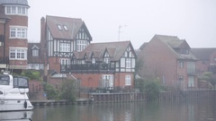 Luxury English houses in the fog by the Thames river Stock Footage