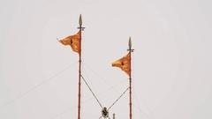 The Nishan Sahib Sikh flag on high flagpole, Golden Temple, Amritsar, India Stock Footage