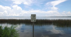 """Fly-over """"Watch for Alligators"""" Sign Stock Footage"""
