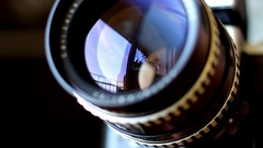 Camera Lens Zoom And Aperture Rings Rotating And Moving on Tripod Stock Footage
