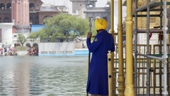 Sikh guardian guard at Golden Temple, Harmandir Sahib, Amritsar, India Stock Footage
