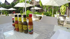 Mexico resort restaurant pepper hot sauce on table HD Stock Footage