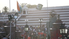 India and Pakistani flag lowered, soldier guards, Wagah border gate ceremony Stock Footage