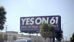 Yes on Prop 61 healthcare proposition on billboard ad on highway in Los Angeles Stock Footage
