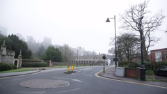 Windsor Castle in a thick white fog - wide establishing shot, England Stock Footage