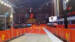 Fans wait for celebs, rain, Berlinale film festival red carpet ceremony, Berlin Stock Footage