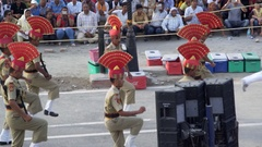 Indian border guard soldiers march, Wagah crossing ceremony, colorful show Stock Footage