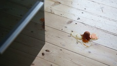 Three fresh brown eggs falling on the kitchen floor and making a mess Stock Footage