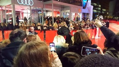 Director of Berlinale film festival Dieter Kosslick gives autographs, red carpet Stock Footage