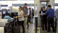 Passengers airport security travelers being checked people in 4K LAX Stock Footage