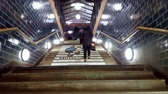 People go up stairs to train station, nighttime, Berlin Germany Stock Footage