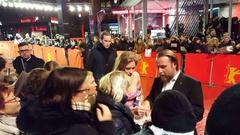 Julia Jentsch and Bjarne Maedel take selfie, Berlinale film festival red carpet Stock Footage